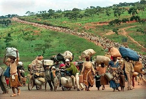 Lines of refugees fleeing for their lives in rwanda and in burundi